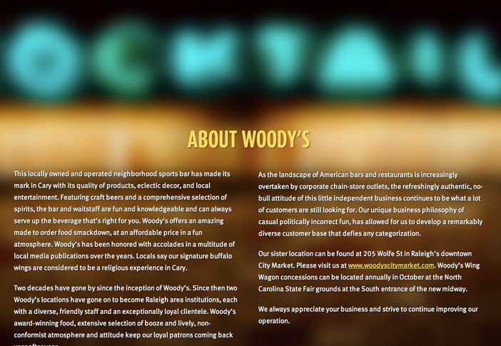 About Woody's with a Neon Cocktails Sign