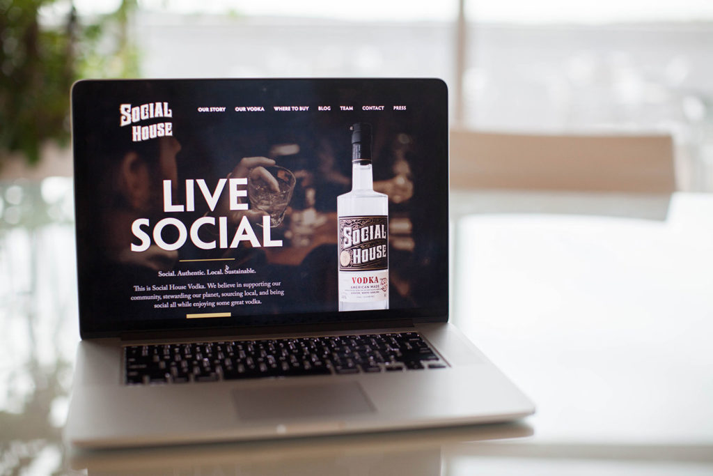 Live Social homepage on laptop